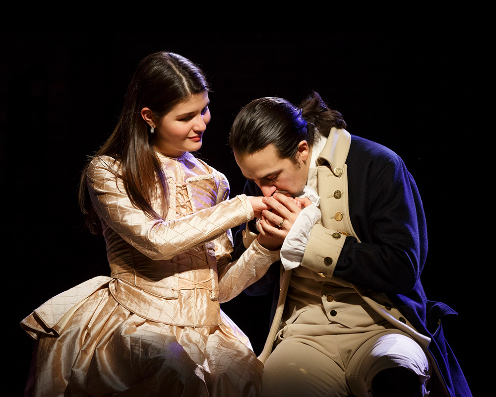 "Phillipa Soo as ""Elizabeth Schuyler Hamilton"" and Lin-Manuel Miranda as ""Alexander Hamilton"" 